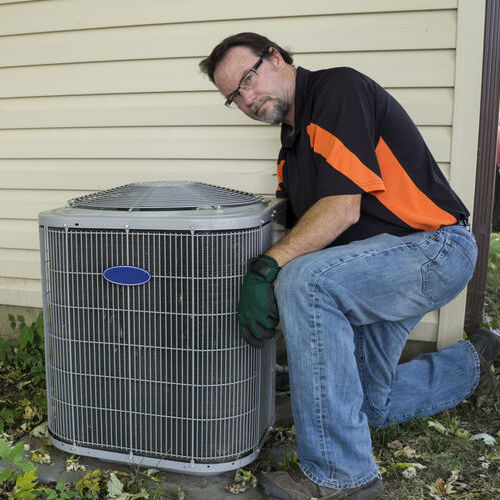 A Technician Tests an Air Conditioner.